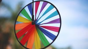 Thai street decoration. Close up of colorful spinner on blurred blue sky background. 1920x1080 stock video