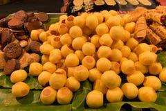 Thai street Dessert at night market. Grilled Sweet Potato, Coconut pancake  and Tokyo Pancake Sausage (Thai street Dessert Royalty Free Stock Photos