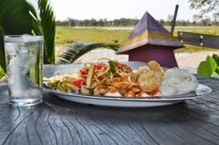Thai street food. Delicious Thai food: papaya salad (Som Tam) with a glass of water stock photos