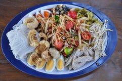 Thai street food. Delicious Thai food: papaya salad (Som Tam) on a wooden table stock photo