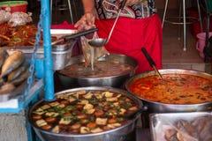 Thai street food market or restaurant in Thailand. Soups in thai street market stock images