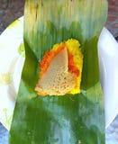 Thai street foods. Rice turmeric custard on banana leaf Royalty Free Stock Photos
