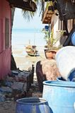 Thai street with ocean view. Small street with barrels, flowers and view of the ocean tide royalty free stock image