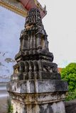 Thai Stucco pattern on the ancient pagoda or Prang Side view royalty free stock photo