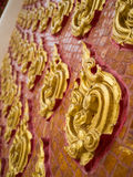 Thai stucco. Perspective Thai traditional stucco, red and gold painted Royalty Free Stock Image