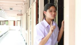 Thai student High School beautiful girl relax and playing in school stock footage
