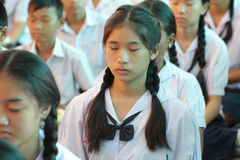 Thai student Meaning meditation. BANGKOK, THAILAND - MAR 11, 2015: Unknown children, Thai student Meaning meditation, at Elementary School. bangkok at 2015 royalty free stock photography