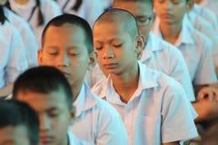 Thai student Meaning meditation. BANGKOK, THAILAND -  MAR 11, 2015: Unknown children, Thai student Meaning meditation, at  Elementary School. bangkok at 2015 Royalty Free Stock Photos