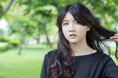 Thai student teen beautiful girl Black Dresses relax in park Royalty Free Stock Image