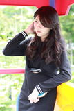 Thai student teen beautiful girl Black Dresses relax in park Royalty Free Stock Images