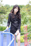 Thai student teen beautiful girl Black Dresses relax in park. Portrait of thai student teen beautiful girl Black Dresses relax in park stock photography