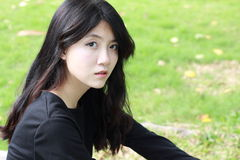 Thai student teen beautiful girl Black Dresses relax in park Stock Photo