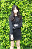 Thai student teen beautiful girl Black Dresses relax in park. Portrait of thai student teen beautiful girl Black Dresses relax in park stock image