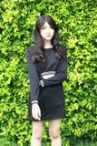Thai student teen beautiful girl Black Dresses relax in park Stock Image