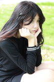 Thai student teen beautiful girl Black Dresses relax in park Royalty Free Stock Photo
