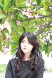 Thai student teen beautiful girl Black Dresses relax in park Stock Images