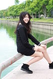 Thai student teen beautiful girl Black Dresses relax and smile. Stock Image