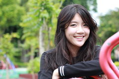 Thai student teen beautiful girl Black Dresses relax and smile. Stock Photos