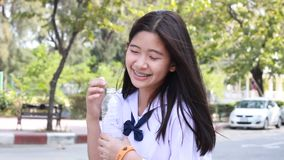 Thai student teen beautiful girl give drinking water stock footage