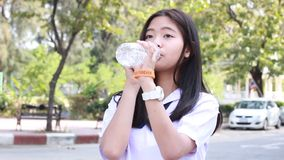 Thai student teen beautiful girl give drinking water stock video footage