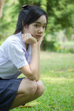 Thai student teen beautiful girl relax and smile in park. Stock Photos