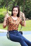 Thai student teen beautiful girl relax and smile in park. Royalty Free Stock Image