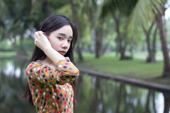 Thai student teen beautiful girl relax and smile in park. Portrait of thai student teen beautiful girl relax and smile in park stock images