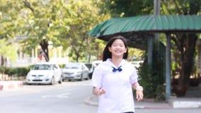 Thai student teen beautiful girl run and bye bye. stock video