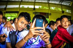 Thai Student Use Mobile Phone Take a photo. Stock Photo
