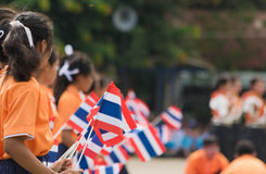 Thai students participating the ceremony of 100th aniversary of current Thai`s national flag.. In August,28. Thai government held ceremony of 100th anniversary Royalty Free Stock Photography