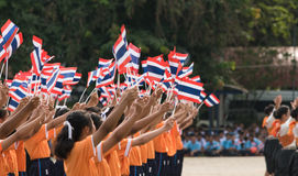 Thai students participating the ceremony of 100th aniversary of current Thai`s national flag.. In August,28. Thai government held ceremony of 100th anniversary Stock Photo