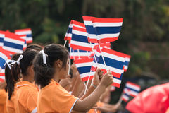 Thai students participating the ceremony of 100th aniversary of current Thai`s national flag.  Stock Photos
