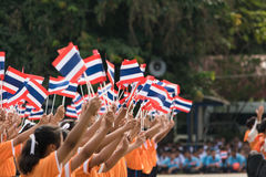 Thai students participating the ceremony of 100th aniversary of current Thai`s national flag.. In August,28. Thai government held ceremony of 100th anniversary Royalty Free Stock Photo