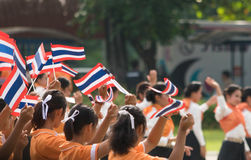 Thai students participating the ceremony of 100th aniversary of current Thai`s national flag.  Royalty Free Stock Image