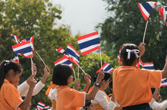 Thai students participating the ceremony of 100th aniversary of current Thai`s national flag.. In August,28. Thai government held ceremony of 100th anniversary Royalty Free Stock Photos