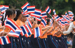 Thai students participating the ceremony of 100th aniversary of current Thai`s national flag.. In August,28. Thai government held ceremony of 100th anniversary Stock Photos