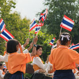 Thai students participating the ceremony of 100th aniversary of current Thai`s national flag.  Stock Photo