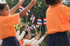 Thai students participating the ceremony of 100th aniversary of current Thai`s national flag.  Royalty Free Stock Photo