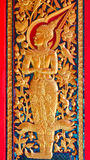 Thai style angel sculpter at temple door in Thailand Stock Photos