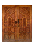 Thai style antique carved wooden door of teak wood Stock Photos