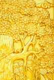 Thai style art golden tree carving on temple door Stock Image
