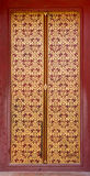 Thai style art painting on door of the temple Royalty Free Stock Photo