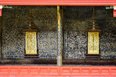 Thai style art painting wall and golden windows Thai temple bang. Kok Thailand Royalty Free Stock Photos