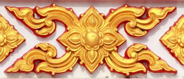 Thai style art pattern. Pattern of Thai style molding art at the wall of temple Stock Photo