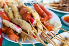 Thai style BBQ Pork, Sausage, Crab sticks royalty free stock photos