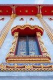 Thai style buddhism temple golden window. Thai style traditional buddhism temple golden window detail Stock Image