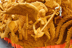 Thai style candle wax carving in the traditional candle festival. Royalty Free Stock Image