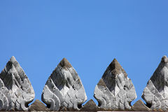 Thai style cement sculpture on temple wall Stock Image
