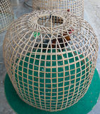 Thai style chicken coop on ground. With chicken inside Stock Photography