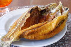 Thai Style Crispy Fried Fish. Clear Lighting of Thai Style Crispy Fried Fish Served on Elegant Dishes Royalty Free Stock Photography